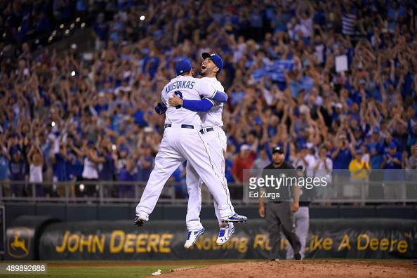 Mike Moustakas and Eric Hosmer of the Kansas City Royals embrace as they cerebrate after thaking the American League Central Division title at...