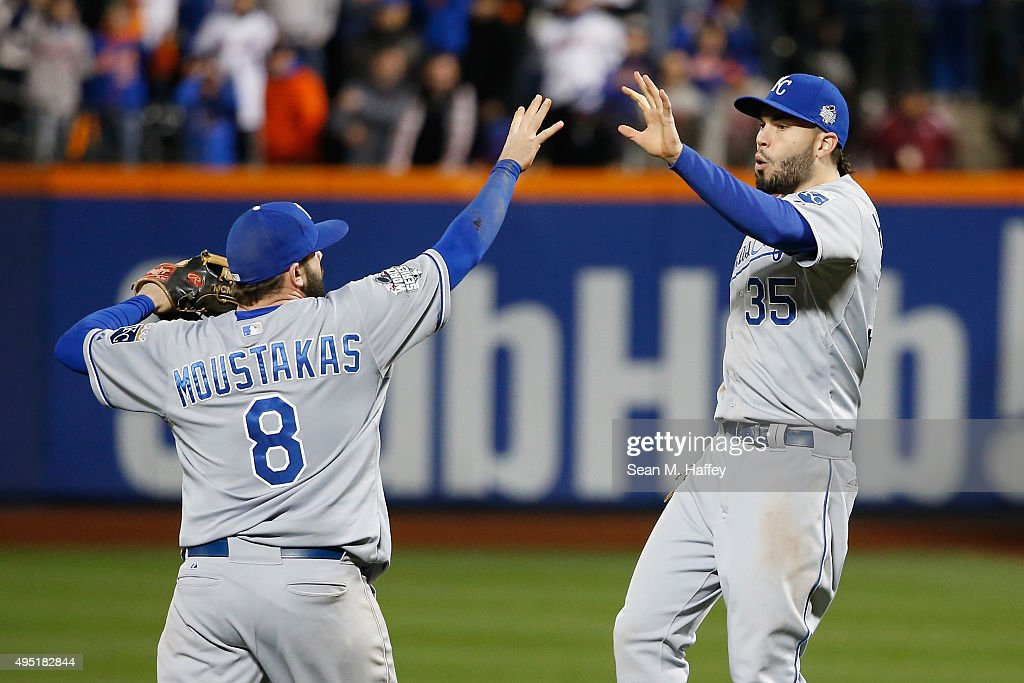 <a gi-track='captionPersonalityLinkClicked' href=/galleries/search?phrase=Mike+Moustakas&family=editorial&specificpeople=6780077 ng-click='$event.stopPropagation()'>Mike Moustakas</a> #8 and <a gi-track='captionPersonalityLinkClicked' href=/galleries/search?phrase=Eric+Hosmer&family=editorial&specificpeople=7091345 ng-click='$event.stopPropagation()'>Eric Hosmer</a> #35 of the Kansas City Royals reacts after defeating the New York Mets by a score of 5-3 to win Game Four of the 2015 World Series at Citi Field on October 31, 2015 in the Flushing neighborhood of the Queens borough of New York City.