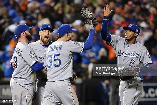 Mike Moustakas Ben Zobrist Eric Hosmer and Alcides Escobar of the Kansas City Royals celebrate after defeating the New York Mets by a score of 53 to...
