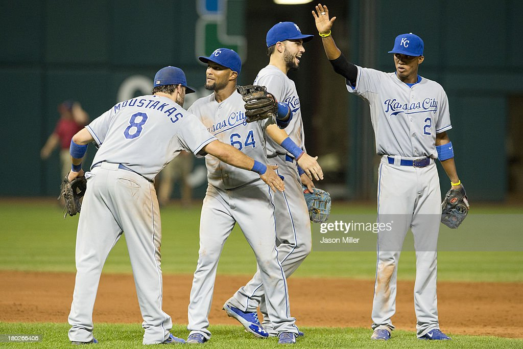 <a gi-track='captionPersonalityLinkClicked' href=/galleries/search?phrase=Mike+Moustakas&family=editorial&specificpeople=6780077 ng-click='$event.stopPropagation()'>Mike Moustakas</a> #8, <a gi-track='captionPersonalityLinkClicked' href=/galleries/search?phrase=Emilio+Bonifacio&family=editorial&specificpeople=4193706 ng-click='$event.stopPropagation()'>Emilio Bonifacio</a> #64, <a gi-track='captionPersonalityLinkClicked' href=/galleries/search?phrase=Eric+Hosmer&family=editorial&specificpeople=7091345 ng-click='$event.stopPropagation()'>Eric Hosmer</a> #35, and <a gi-track='captionPersonalityLinkClicked' href=/galleries/search?phrase=Alcides+Escobar&family=editorial&specificpeople=4845889 ng-click='$event.stopPropagation()'>Alcides Escobar</a> #2 of the Kansas City Royals celebrate after defeating the Cleveland Indians at Progressive Field on September 10, 2013 in Cleveland, Ohio. The Royals defeated the Indians 6-3.