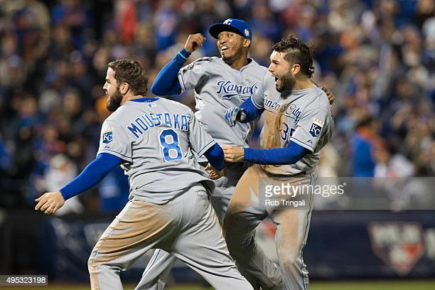 Mike Moustakas Eric Hosmer and Alcides Escobar of the Kansas City Royals celebrate on the field after defeating the New York Mets in Game 5 of the...