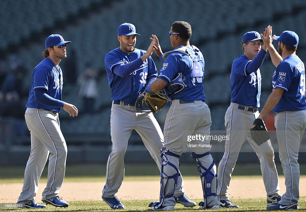 Mike Moustakas #8 (L-R), Eric Hosmer #35, Salvador Perez #13, Chris Getz #17 and Greg Holland #56 celebrate their win over the Chicago White Sox on April 4, 2012 at U.S. Cellular Field in Chicago, Illinois. The Royals defeated the White Sox 3-1.