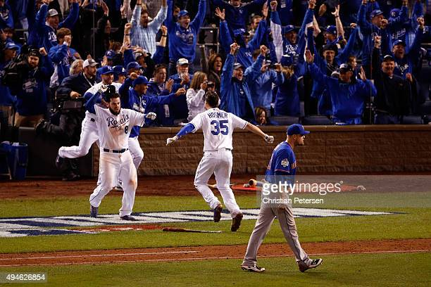 Mike Moustakas of the Kansas City Royals and Eric Hosmer of the Kansas City Royals celebrate defeating the New York Mets 54 in Game One of the 2015...