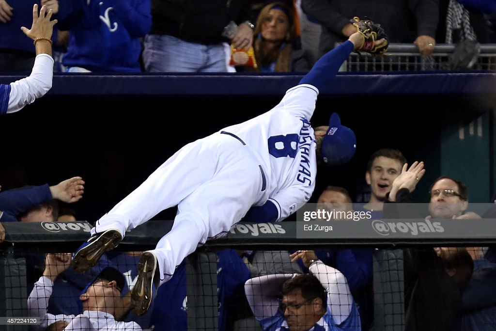 <a gi-track='captionPersonalityLinkClicked' href=/galleries/search?phrase=Mike+Moustakas&family=editorial&specificpeople=6780077 ng-click='$event.stopPropagation()'>Mike Moustakas</a> #8 of the Kansas City Royals catches a foul ball hit by <a gi-track='captionPersonalityLinkClicked' href=/galleries/search?phrase=Adam+Jones+-+Baseball+Player&family=editorial&specificpeople=5460465 ng-click='$event.stopPropagation()'>Adam Jones</a> #10 of the Baltimore Orioles in the sixth inning during Game Three of the American League Championship Series at Kauffman Stadium on October 14, 2014 in Kansas City, Missouri.