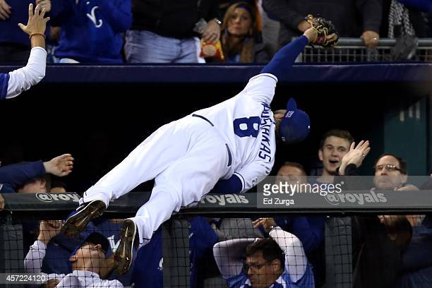 Mike Moustakas of the Kansas City Royals catches a foul ball hit by Adam Jones of the Baltimore Orioles in the sixth inning during Game Three of the...
