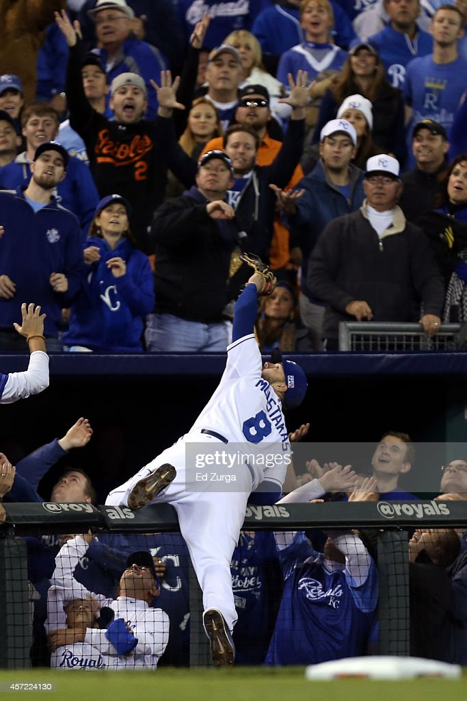<a gi-track='captionPersonalityLinkClicked' href=/galleries/search?phrase=Mike+Moustakas&family=editorial&specificpeople=6780077 ng-click='$event.stopPropagation()'>Mike Moustakas</a> #8 of the Kansas City Royals catches a foul ball hit by Adam Jones #10 of the Baltimore Orioles in the sixth inning during Game Three of the American League Championship Series at Kauffman Stadium on October 14, 2014 in Kansas City, Missouri.