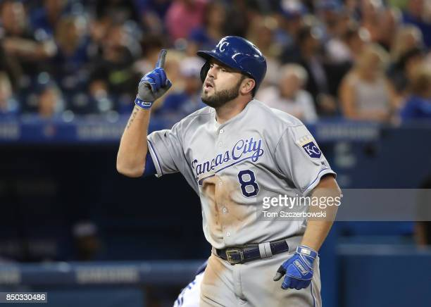 Mike Moustakas of the Kansas City Royals celebrates after hitting a solo home run in the sixth inning setting a club record with 37 home runs in a...