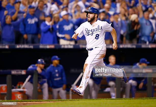 Mike Moustakas of the Kansas City Royals celebrates after scoring a run in the seventh inning against the Toronto Blue Jays in game six of the 2015...