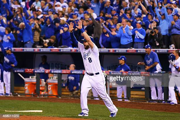 Mike Moustakas of the Kansas City Royals celebrates after scoring in the second inning against the San Francisco Giants during Game Six of the 2014...