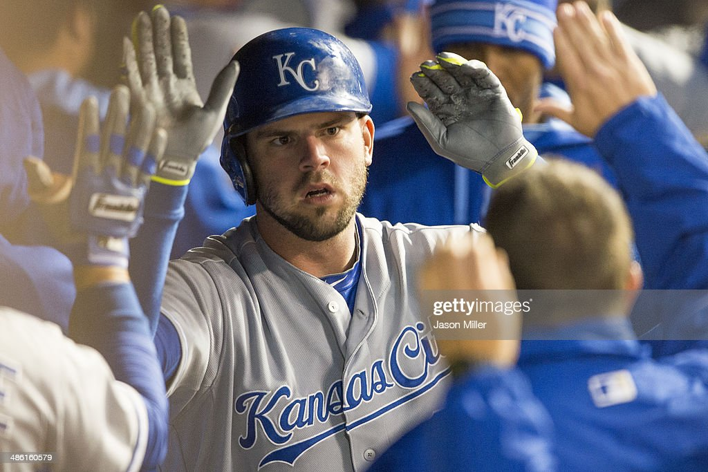 <a gi-track='captionPersonalityLinkClicked' href=/galleries/search?phrase=Mike+Moustakas&family=editorial&specificpeople=6780077 ng-click='$event.stopPropagation()'>Mike Moustakas</a> #8 of the Kansas City Royals celebrates in the dugout after hitting a three run home run during the fourth inning against the Cleveland Indians at Progressive Field on April 22, 2014 in Cleveland, Ohio.