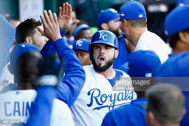 Mike Moustakas of the Kansas City Royals celebrates in the dugout after scoring a run in the seventh inning against the Toronto Blue Jays in game two...