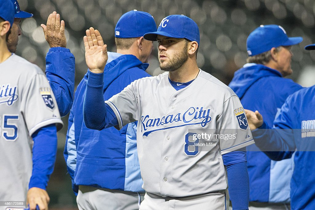<a gi-track='captionPersonalityLinkClicked' href=/galleries/search?phrase=Mike+Moustakas&family=editorial&specificpeople=6780077 ng-click='$event.stopPropagation()'>Mike Moustakas</a> #8 of the Kansas City Royals celebrates with teammates after the Royals defeated the Cleveland Indians at Progressive Field on April 22, 2014 in Cleveland, Ohio. The Royals defeated the Indians 8-2.