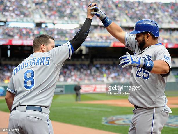Mike Moustakas of the Kansas City Royals congratulates teammate Kendrys Morales on a solo home run against the Minnesota Twins during the second...