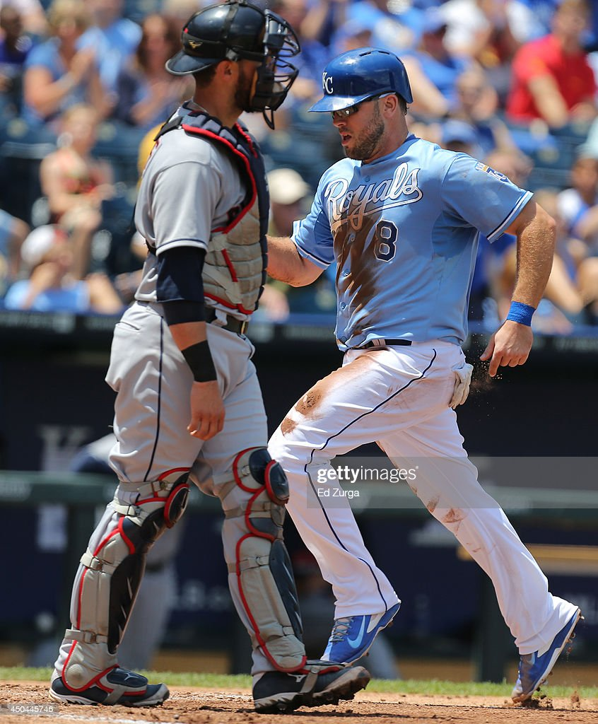 <a gi-track='captionPersonalityLinkClicked' href=/galleries/search?phrase=Mike+Moustakas&family=editorial&specificpeople=6780077 ng-click='$event.stopPropagation()'>Mike Moustakas</a> #8 of the Kansas City Royals crosses home past <a gi-track='captionPersonalityLinkClicked' href=/galleries/search?phrase=Yan+Gomes&family=editorial&specificpeople=9004037 ng-click='$event.stopPropagation()'>Yan Gomes</a> #10 of the Cleveland Indians as he scores on a Jarrod Dyson sacrifice fly in the third inning at Kauffman Stadium on June 11, 2014 in Kansas City, Missouri.