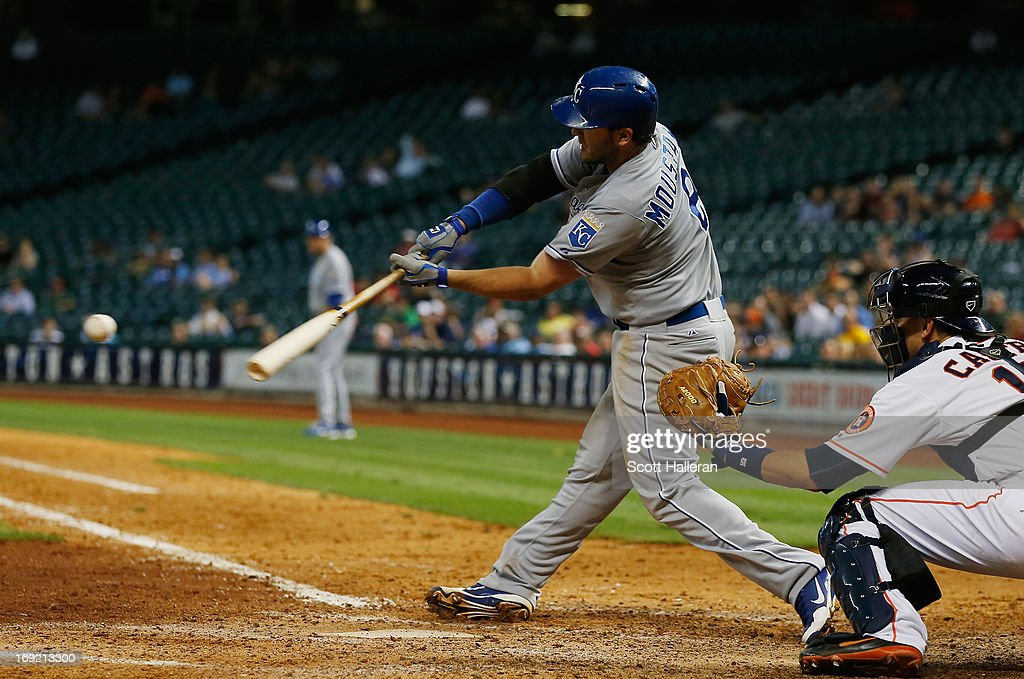 <a gi-track='captionPersonalityLinkClicked' href=/galleries/search?phrase=Mike+Moustakas&family=editorial&specificpeople=6780077 ng-click='$event.stopPropagation()'>Mike Moustakas</a> #8 of the Kansas City Royals drives in a run in the eighth inning against the Houston Astros at Minute Maid Park on May 21, 2013 in Houston, Texas.