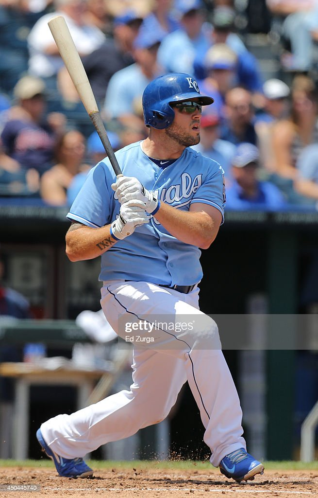 Mike Moustakas #8 of the Kansas City Royals hits a double in the third inning against the Cleveland Indians at Kauffman Stadium on June 11, 2014 in Kansas City, Missouri.