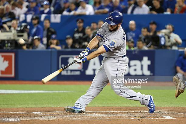 Mike Moustakas of the Kansas City Royals hits a sacrifice fly ball to score Eric Hosmer of the Kansas City Royals in the first inning against the...