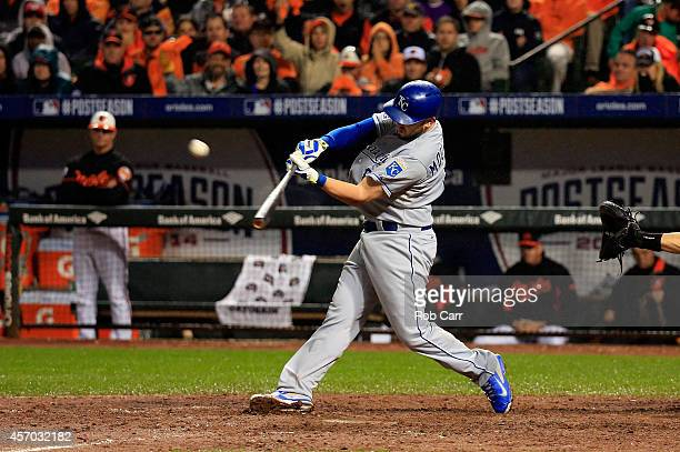 Mike Moustakas of the Kansas City Royals hits a two run home run to right center field against Brian Matusz of the Baltimore Orioles in the tenth...
