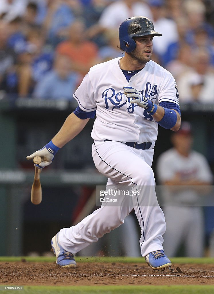 Mike Moustakas #8 of the Kansas City Royals hits a two-run single in the second inning during a game against the Minnesota Twins at Kauffman Stadium August, 5, 2013 in Kansas City, Missouri.