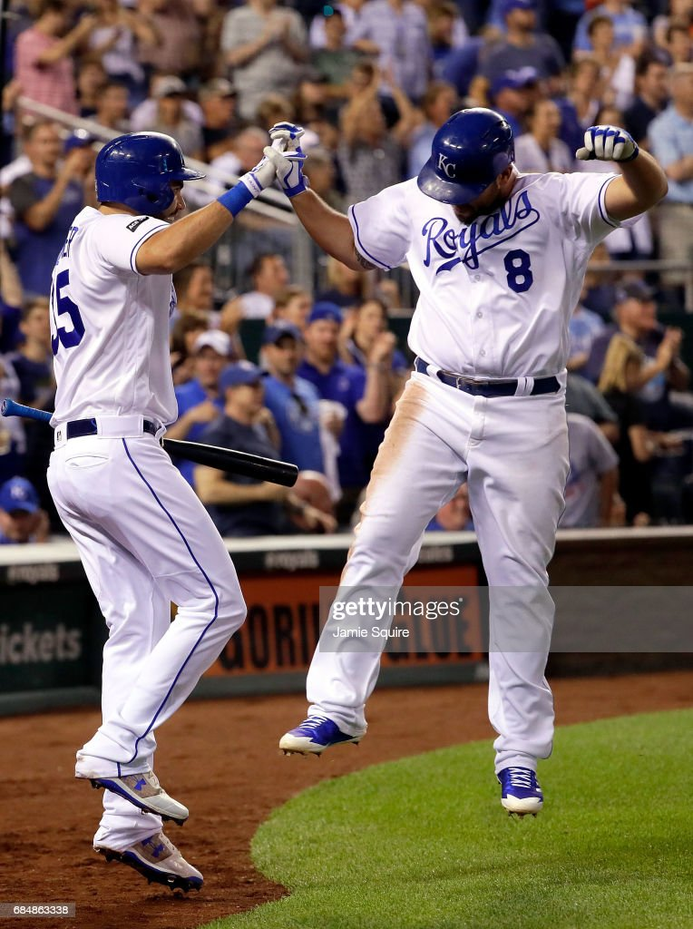Mike Moustakas #8 of the Kansas City Royals is congratulated by Eric Hosmer #35 after hitting a 3-run home run during the 5th inning of the game against the New York Yankees at Kauffman Stadium on May 18, 2017 in Kansas City, Missouri.