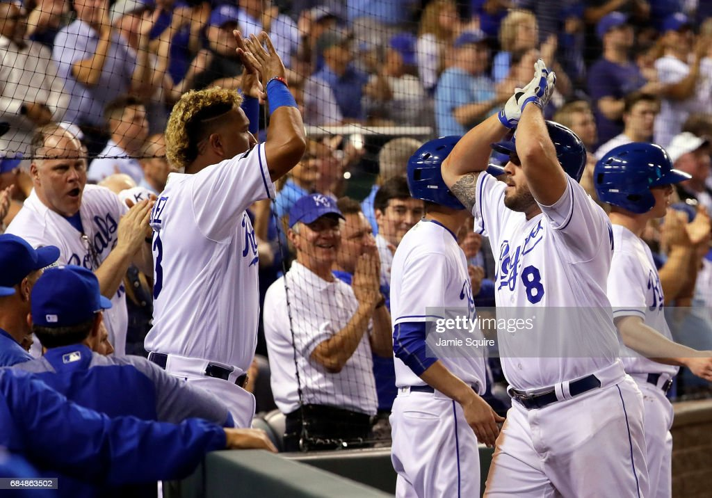 Mike Moustakas #8 of the Kansas City Royals is congratulated by Salvador Perez #13 after hitting a 3-run home run during the 5th inning of the game against the New York Yankees at Kauffman Stadium on May 18, 2017 in Kansas City, Missouri.