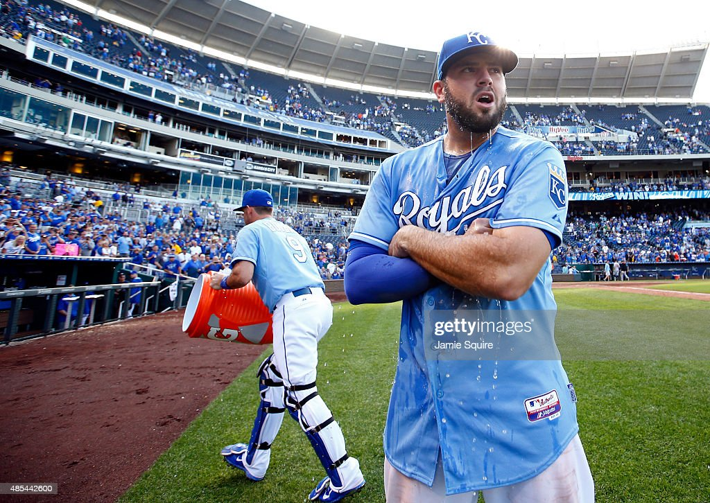 Mike Moustakas #8 of the Kansas City Royals is doused with water by catcher Drew Butera #9 after the Royals defeated the Baltimore Orioles 5-3 to win the game at Kauffman Stadium on August 27, 2015 in Kansas City, Missouri.