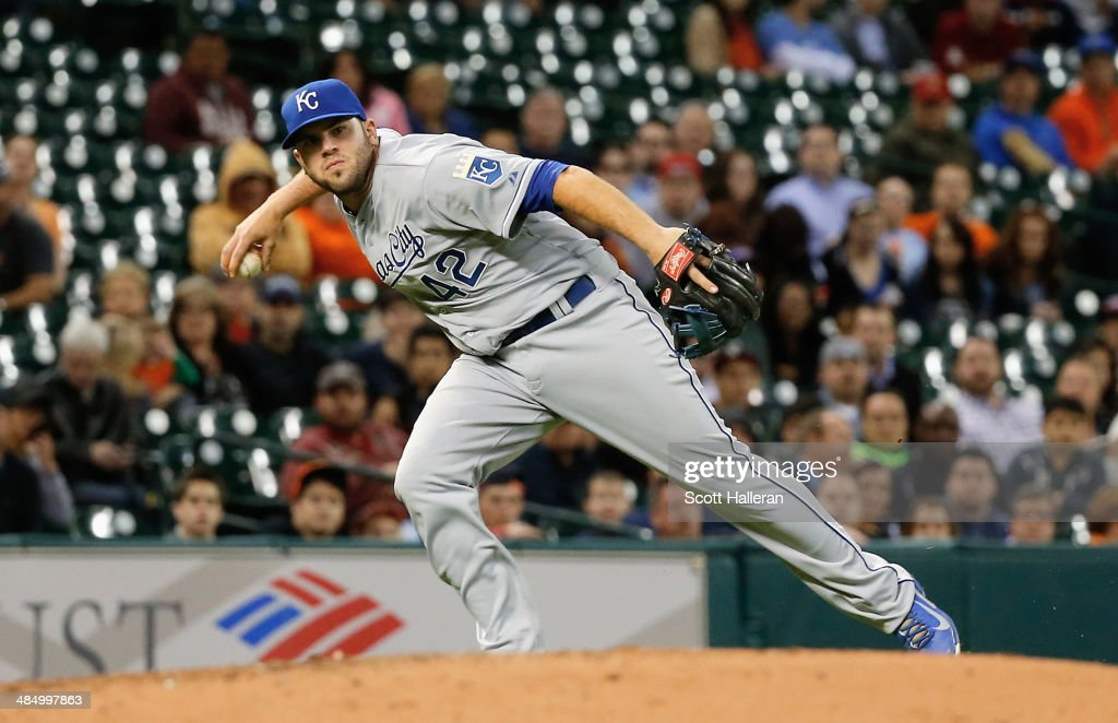 <a gi-track='captionPersonalityLinkClicked' href=/galleries/search?phrase=Mike+Moustakas&family=editorial&specificpeople=6780077 ng-click='$event.stopPropagation()'>Mike Moustakas</a> of the Kansas City Royals makes a play at third base in the fifth inning against the Houston Astros at Minute Maid Park on April 15, 2014 in Houston, Texas. All uniformed team members are wearing jersey number 42 in honor of Jackie Robinson Day.