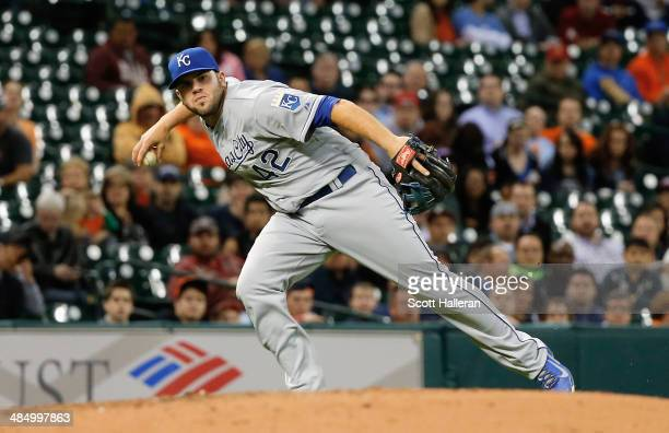 Mike Moustakas of the Kansas City Royals makes a play at third base in the fifth inning against the Houston Astros at Minute Maid Park on April 15...