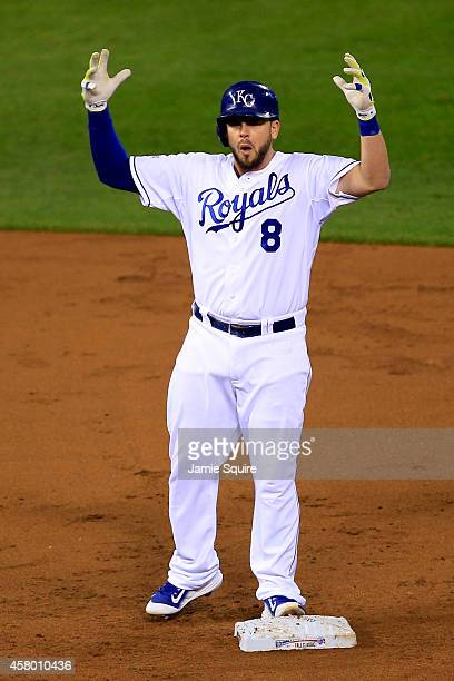 Mike Moustakas of the Kansas City Royals reacts after hitting an RBI double in the second inning against the San Francisco Giants during Game Six of...