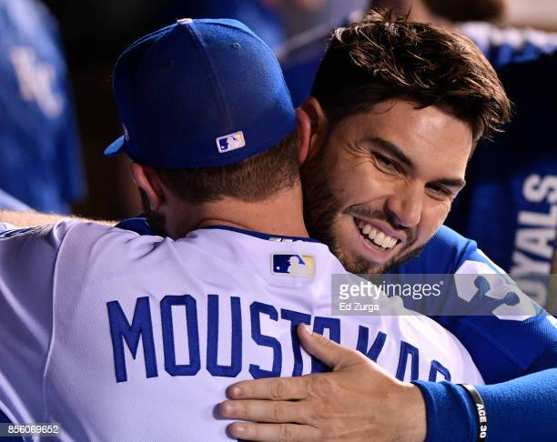 Mike Moustakas of the Kansas City Royals receives a hug from Eric Hosmer after he was taken out of a game against the Arizona Diamondbacks in the...