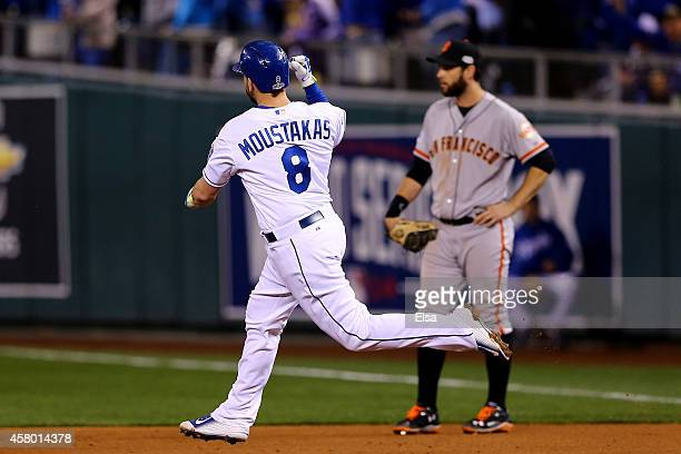 Mike Moustakas of the Kansas City Royals rounds the bases after hitting a solo home run in the seventh inning against the San Francisco Giants during...