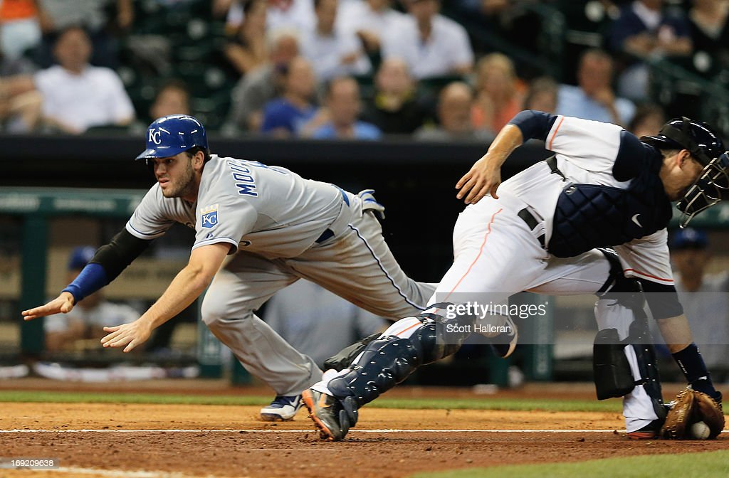 <a gi-track='captionPersonalityLinkClicked' href=/galleries/search?phrase=Mike+Moustakas&family=editorial&specificpeople=6780077 ng-click='$event.stopPropagation()'>Mike Moustakas</a> #8 of the Kansas City Royals scores a run in the seventh inning past Jason Castro #15 of the Houston Astros at Minute Maid Park on May 21, 2013 in Houston, Texas.