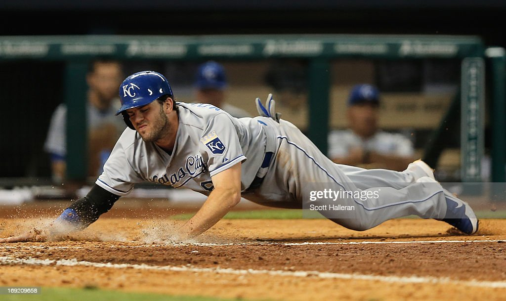 <a gi-track='captionPersonalityLinkClicked' href=/galleries/search?phrase=Mike+Moustakas&family=editorial&specificpeople=6780077 ng-click='$event.stopPropagation()'>Mike Moustakas</a> #8 of the Kansas City Royals scores a run in the seventh inning against the Houston Astros at Minute Maid Park on May 21, 2013 in Houston, Texas.