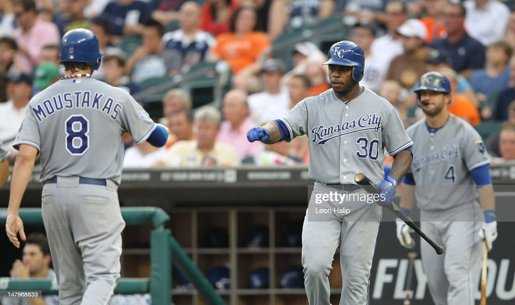 <a gi-track='captionPersonalityLinkClicked' href=/galleries/search?phrase=Mike+Moustakas&family=editorial&specificpeople=6780077 ng-click='$event.stopPropagation()'>Mike Moustakas</a> #8 of the Kansas City Royals scores on a double by Brayan Pena #27 during the fifth inning and is congratulated by teammate <a gi-track='captionPersonalityLinkClicked' href=/galleries/search?phrase=Jason+Bourgeois&family=editorial&specificpeople=2495327 ng-click='$event.stopPropagation()'>Jason Bourgeois</a> #30 during the game against the Detroit Tigers at Comerica Park on July 6, 2012 in Detroit, Michigan. The Tigers defeated the Royal 4-2.