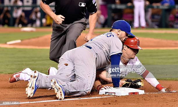Mike Moustakas of the Kansas City Royals tags out Collin Cowgill of the Los Angeles Angels at third base in the eighth inning during Game Two of the...