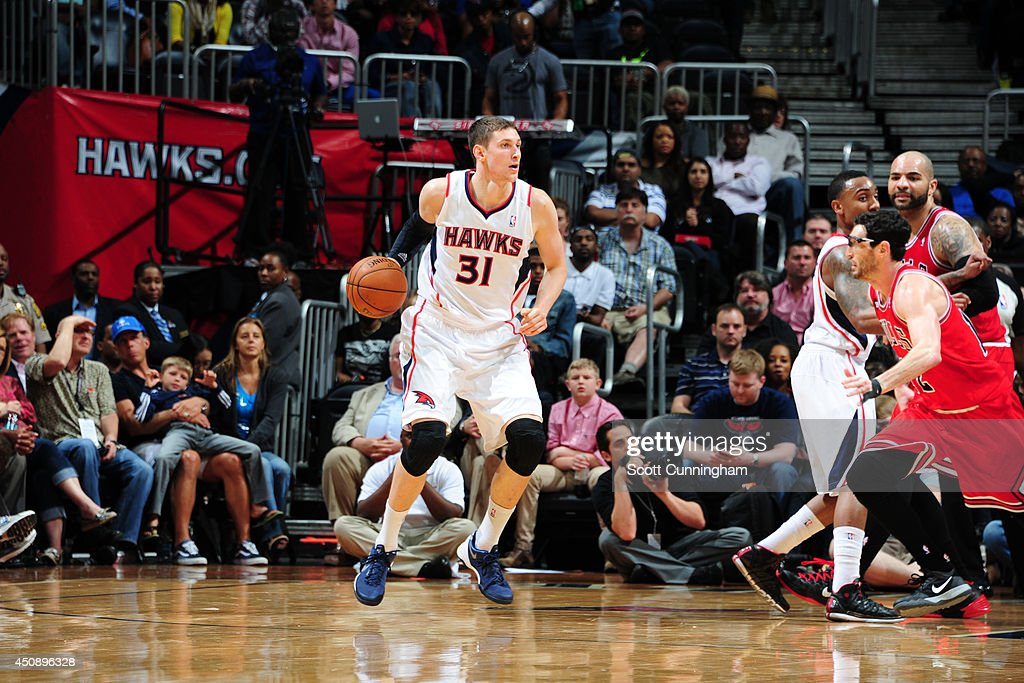 <a gi-track='captionPersonalityLinkClicked' href=/galleries/search?phrase=Mike+Muscala&family=editorial&specificpeople=7563430 ng-click='$event.stopPropagation()'>Mike Muscala</a> #31 of the Atlanta Hawks controls the ball against the Chicago Bulls on April 2, 2014 at Philips Arena in Atlanta, Georgia.