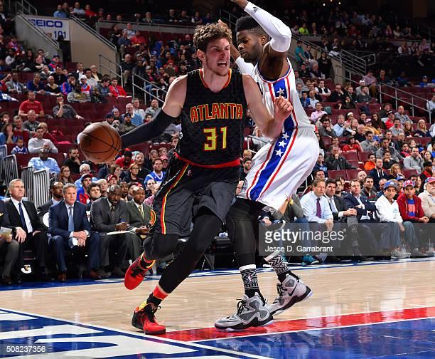 Mike Muscala of the Atlanta Hawks drives baseline against the Philadelphia 76ers at Wells Fargo Center on February 3 2016 in Philadelphia...