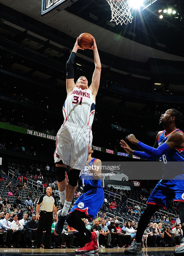 Mike Muscala #31 of the Atlanta Hawks dunks against the Philadelphia 76ers on March 31, 2014 at Philips Arena in Atlanta, Georgia.
