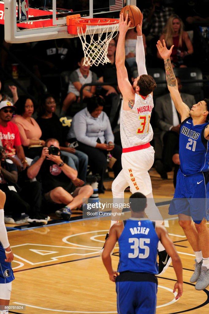 Mike Muscala #31 of the Atlanta Hawks goes to the basket against the Dallas Mavericks on October 12, 2017 at McCamish Pavilion in Atlanta, Georgia.