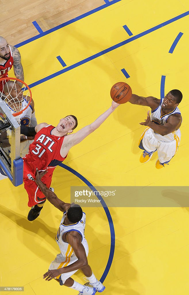 Mike Muscala #31 of the Atlanta Hawks reaches for the rebound against the Golden State Warriors on March 7, 2014 at Oracle Arena in Oakland, California.