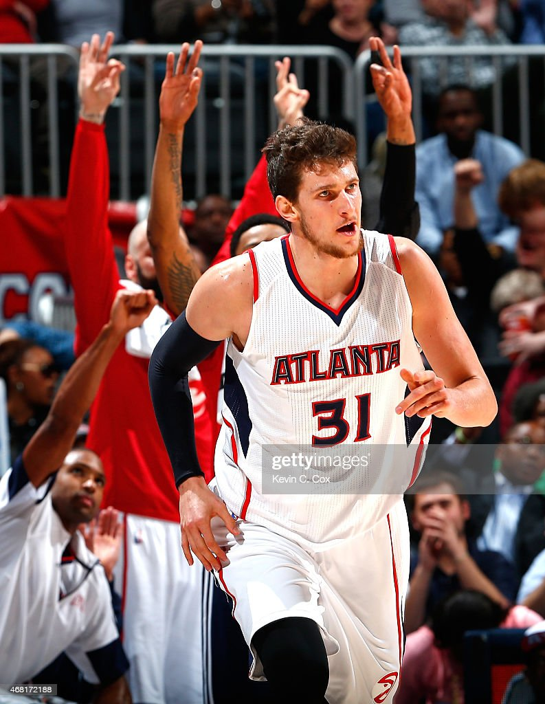 <a gi-track='captionPersonalityLinkClicked' href=/galleries/search?phrase=Mike+Muscala&family=editorial&specificpeople=7563430 ng-click='$event.stopPropagation()'>Mike Muscala</a> #31 of the Atlanta Hawks reacts after hitting a three-point basket against the Milwaukee Bucks at Philips Arena on March 30, 2015 in Atlanta, Georgia.