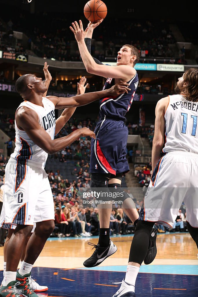 Mike Muscala #31 of the Atlanta Hawks shoots the ball during the game against the Charlotte Bobcats at the Time Warner Cable Arena on March 17, 2014 in Charlotte, North Carolina.