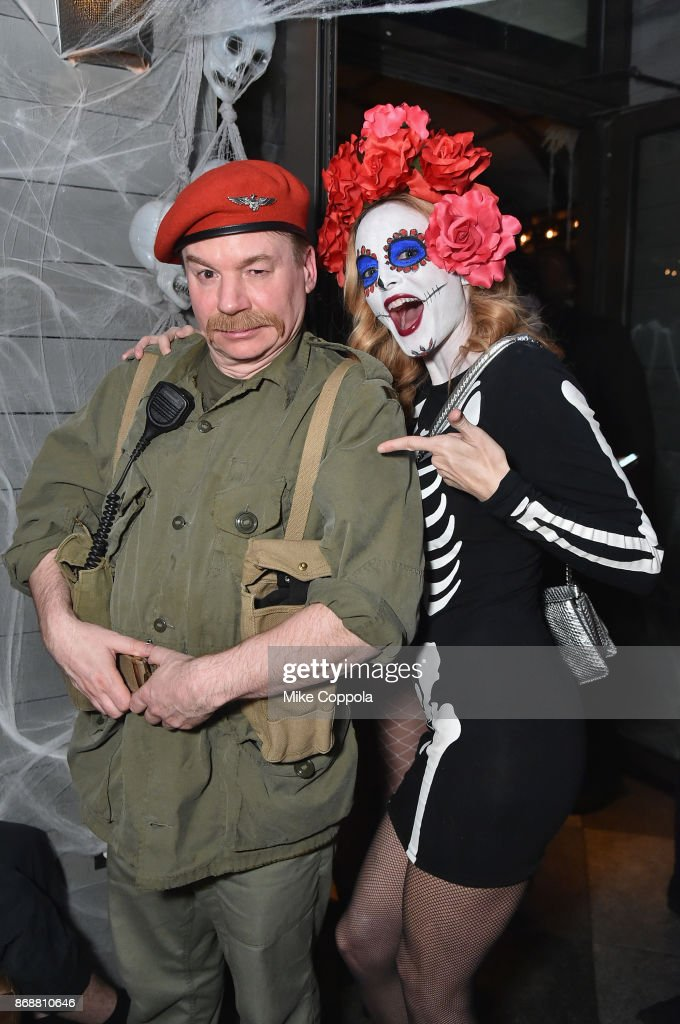 Mike Myers (L) and Heather Graham attend Heidi Klum's 18th Annual Halloween Party presented by Party City and SVEDKA Vodka at Magic Hour Rooftop Bar & Lounge at Moxy Times Square on October 31, 2017 in New York City.