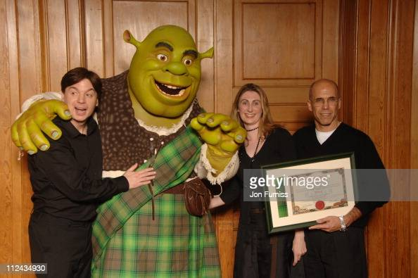 Mike Myers Shrek Jenni Steele and Jeffrey Katzenberg who was presented with an official Scottish Clan Tartan certificate for the character Shrek