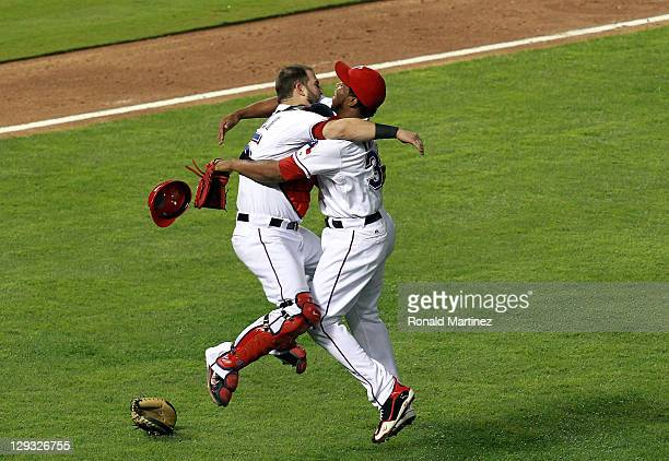 Mike Napoli and Neftali Feliz of the Texas Rangers celebrate winning Game Six of the American League Championship Series 155 against the Detroit...