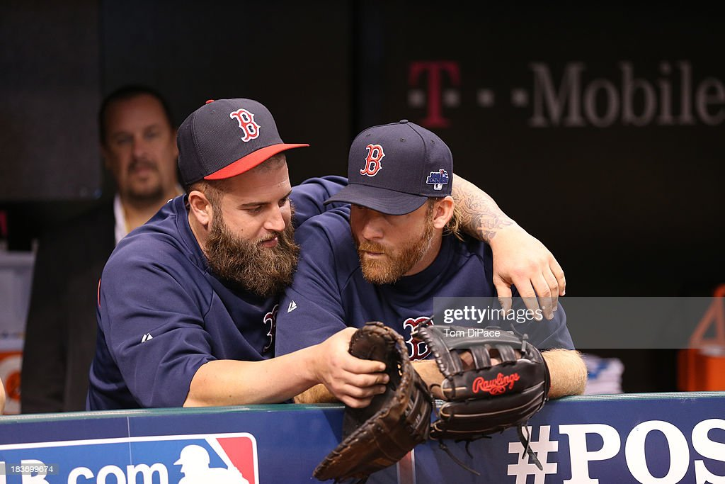 Mike Napoli #12 and Ryan Dempster #46 of the Boston Red Sox talk in the dugout during batting practice before Game 4 of the American League Division Series against the Tampa Bay Rays on Monday, October 8, 2013 at Tropicana Field in St. Petersburg, FL.