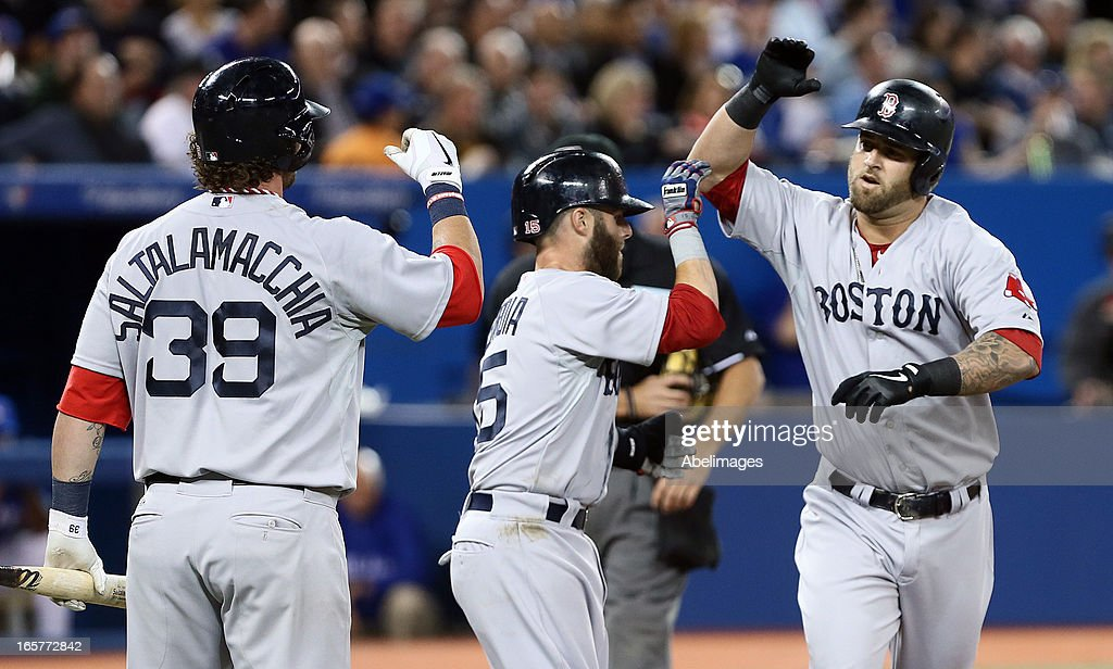 <a gi-track='captionPersonalityLinkClicked' href=/galleries/search?phrase=Mike+Napoli&family=editorial&specificpeople=525007 ng-click='$event.stopPropagation()'>Mike Napoli</a> #12 celebrates a two-run home run with <a gi-track='captionPersonalityLinkClicked' href=/galleries/search?phrase=Jarrod+Saltalamacchia&family=editorial&specificpeople=836404 ng-click='$event.stopPropagation()'>Jarrod Saltalamacchia</a> #39 of the Boston Red Sox and <a gi-track='captionPersonalityLinkClicked' href=/galleries/search?phrase=Daniel+Nava&family=editorial&specificpeople=670454 ng-click='$event.stopPropagation()'>Daniel Nava</a> #29 of the Boston Red Sox against the Toronto Blue Jays during MLB action at the Rogers Centre April 5, 2013 in Toronto, Ontario, Canada.