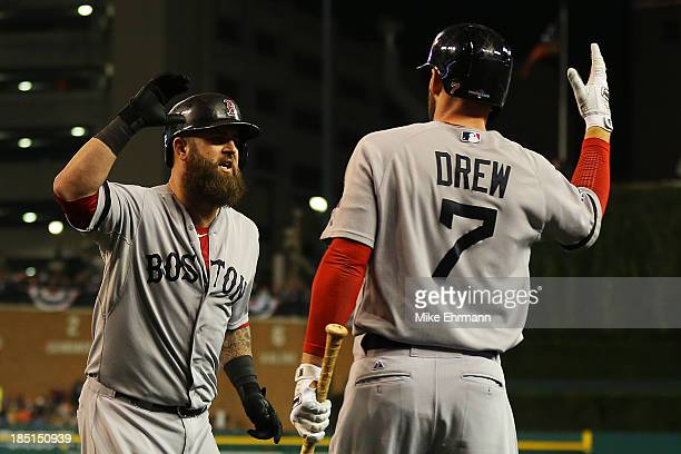 Mike Napoli celebrates his second inning solo homerun with Stephen Drew of the Boston Red Sox during Game Five of the American League Championship...