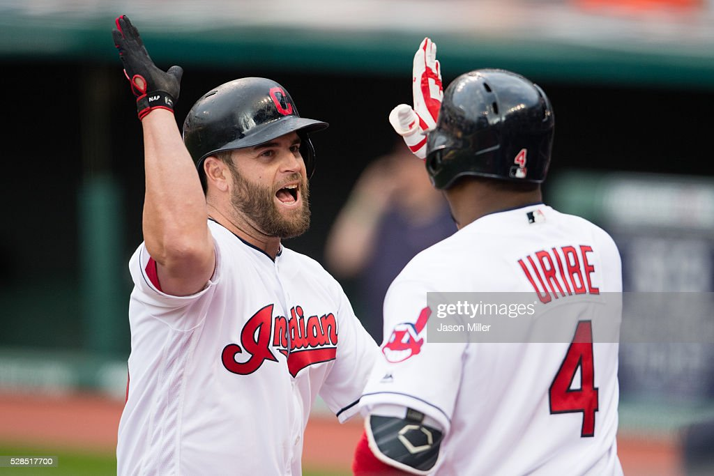 Mike Napoli #26 celebrates with Juan Uribe #4 of the Cleveland Indians after Napoli hit a three run home run during the first inning against the Detroit Tigers at Progressive Field on May 5, 2016 in Cleveland, Ohio.