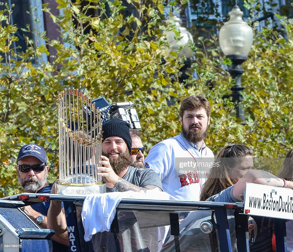 Mike Napoli holding the World Series trophy during the Boston Red Sox World Series victory Rolling Rally as it passes through Copley Square in Boston...